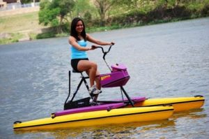 Girl exercising on a purple Hydrobike